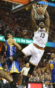 The Cleveland Cavaliers' Tristan Thompson (13) dunks over the Golden State Warriors' James Michael McAdoo during the first quarter in Game 4 of the NBA Finals at Quicken Loans Arena in Cleveland on Friday, June 10, 2016. (Phil Masturzo/Akron Beacon Journal/TNS)